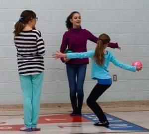 Junior volunteer Julia coaches one to one.
