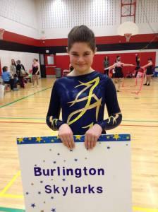 Zoe Marshall proudly holds the Skylarks sign!